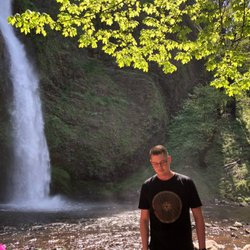 Photo of owner Dan with waterfall in background